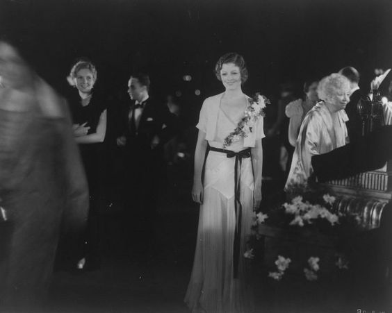 Myrna Loy in a bias cut chiffon dress at a premiere at Carthay Circle Theater in Los Angeles, 1935.