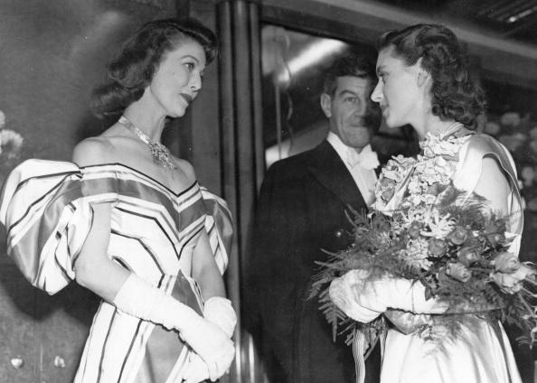 In an exquisite off-the-shoulder striped gown, Loretta Young chats with Princess Margaret at the premiere of  The Bishop's Wife,  1947.
