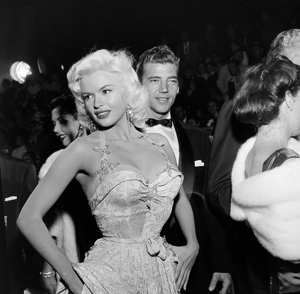 Brocaded lame, beaded butterflies and a killer body made Jayne Mansfield (with husband Mickey Hargitay) the star of the  Giant  premiere in Los Angeles, October 17, 1956.
