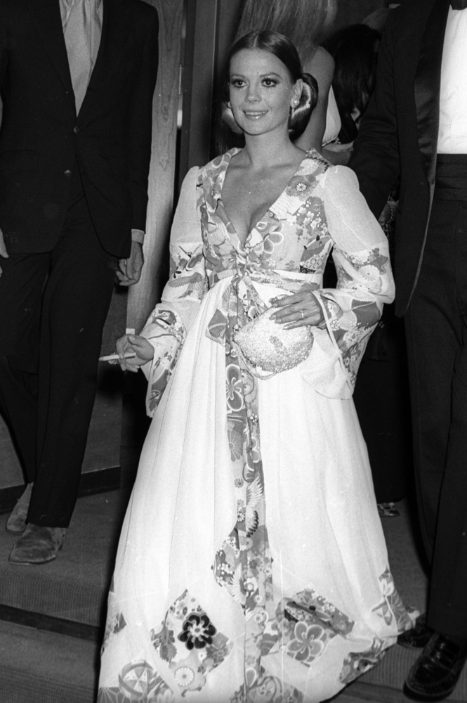 Psychedelic floral silk appliqued on to white organza makes Natalie Wood the belle of the New York Film Festival opening night on September 16, 1969.