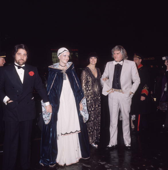 In the dreamiest Bill Gibb gown and velvet cape, Twiggy attends the London premiere of her first starring film, The Boyfriend, with her manager/boyfriend Justin de Villeneuve at the first night of  The Boyfriend  in 1971.