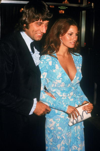 Accompanied by the hottest quarterback ever (Joe Namath), Raquel Welch wears a flower-print slip dress with matching wrap jacket to the Academy Awards on April 10, 1972.