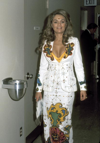 Dyan Cannon rocking a studded white maxi-skirt suit appliqued with a psychedelic velvet design to the 45th Annual Academy Awards on March 27, 1973.