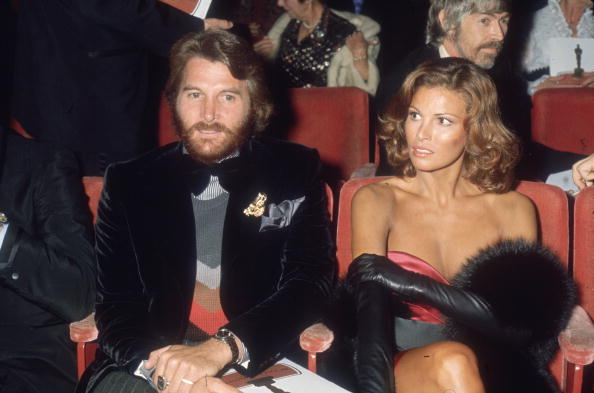 What is hotter than black leather opera gloves? Raquel Welch wearing them with a slinky, strapless dress to the Academy Awards in March 1973.