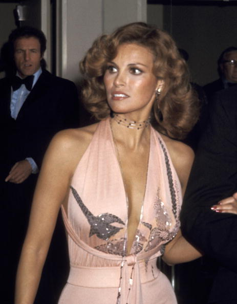 Immaculate waves, plunging peach and tawny skin on Raquel Welch for the 46th Annual Academy Awards in April 1974.