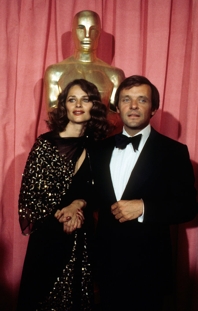 Wearing a vintage 1930s dress, Charlotte Rampling looks stunning backstage at the 1976 Academy Awards with Anthony Hopkins.