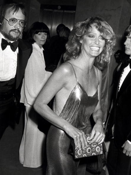 Farrah Fawcett looking flawless in a Stephen Burrows gold chainmail dress at the 50th Academy Awards on April 3, 1978.