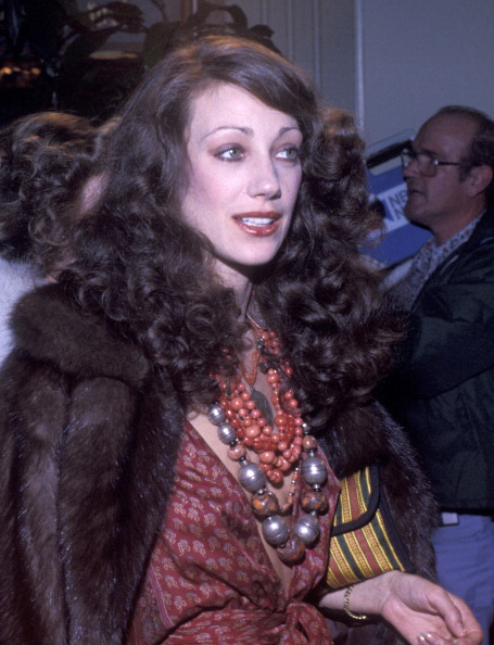 Marisa Berenson attending the Sixth Annual American Film Institute Lifetime Achievement Awards Honoring Henry Fonda on March 1, 1978 at the Beverly Hilton Hotel with heavily piled ethnic jewellery and a mink.