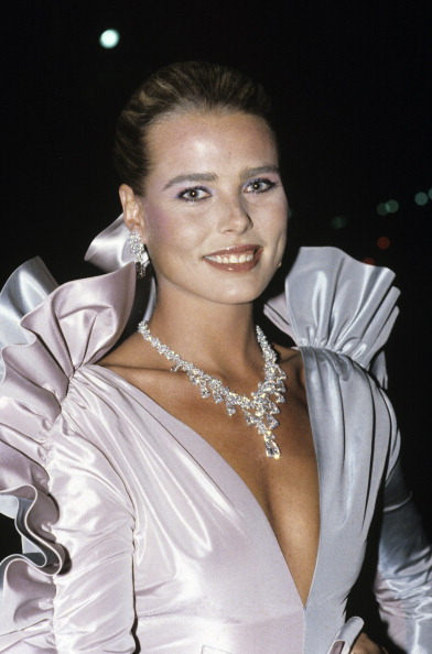 Ruffled YSL and diamonds on Margaux Hemingway for a Gala Dinner In Honour Of Luchino Visconti in Paris, November 1980.