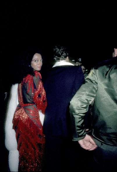 Cascades of red beaded fringe prove Diana Ross is just as glamorous leaving—at the 54th Annual Academy Awards at Dorothy Chandler Pavillion in Los Angeles on March 29, 1982.