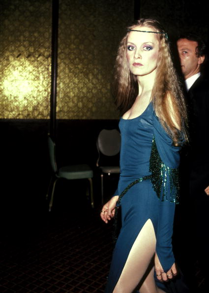 Twiggy killing in in a crimped hair, a headband and a slinky teal dress at the 37th Annual Tony Awards in New York, on June 5, 1983.