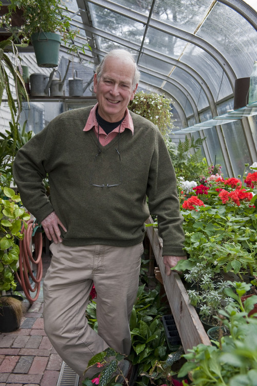 Russell in his greenhouse.