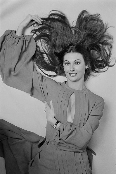 Posing for the press in an Ossie Clark dress, c. 1972.