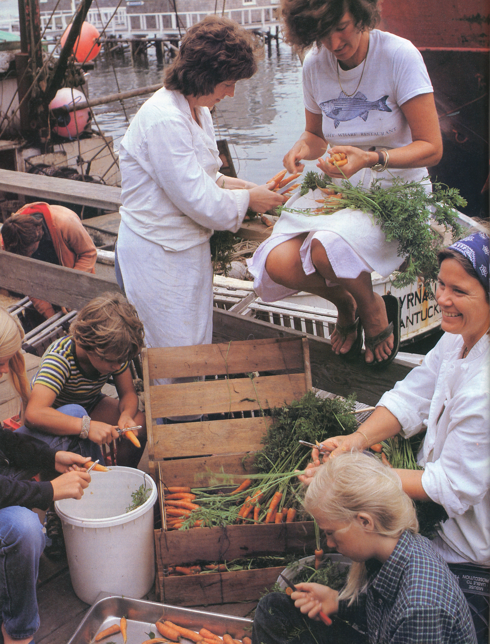 Peeling carrots outside the Straight Wharf restaurant. From 'The Victory Garden Cookbook', 1982.