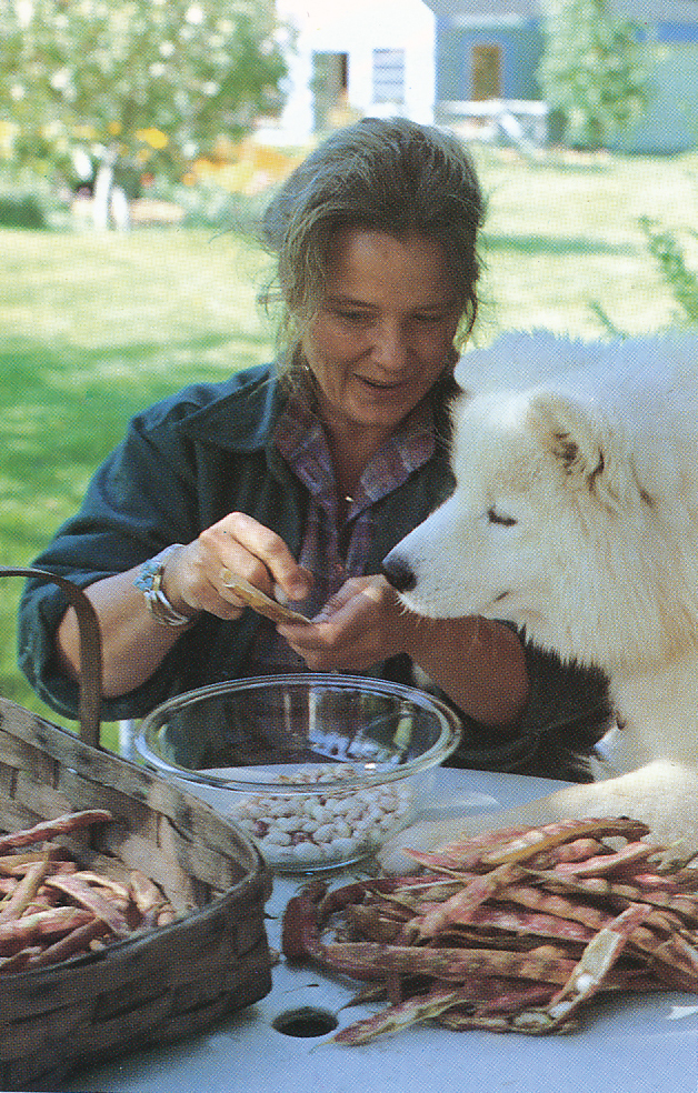 Marian Morash shelling peas with their dog. From 'The Victory Garden Cookbook', 1982.