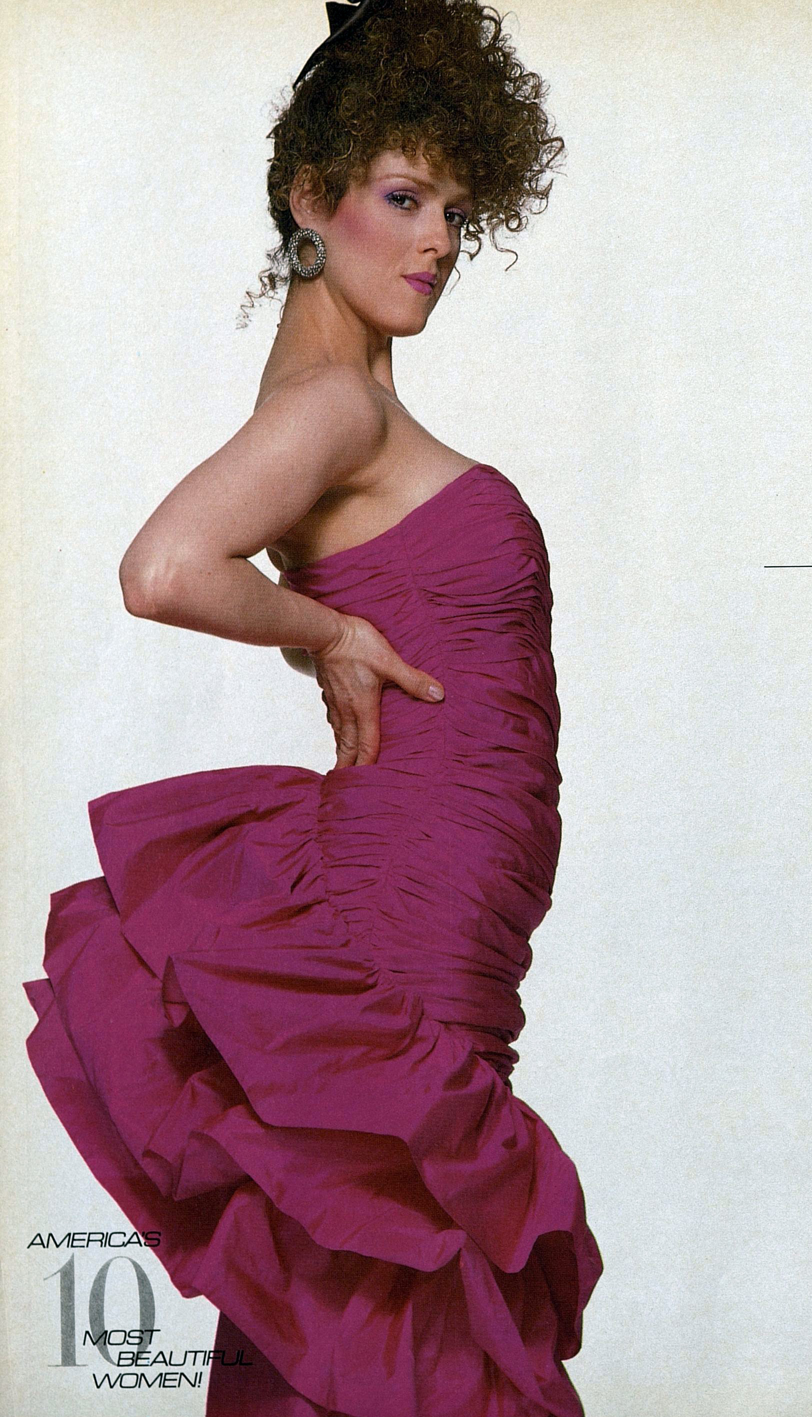 Bernadette Peter's in a bustled and ruffled version; photo by Francesco Scavullo for Harper's Bazaar, September 1984.