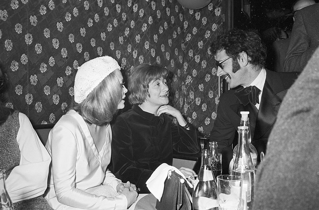Jerry Schatzberg and Faye Dunaway with Françoise Sagan at the afterparty for the French premiere of 'Bonnie & Clyde' on January 24, 1968.