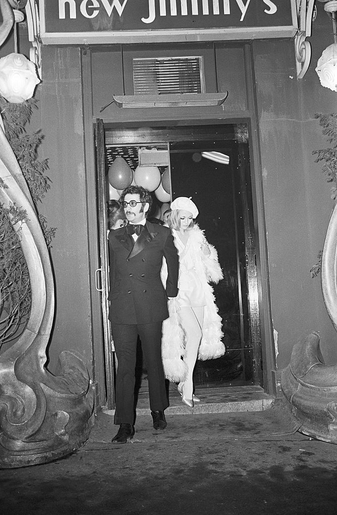 Jerry Schatzberg and Faye Dunaway leaving the afterparty at New Jimmy's for the French premiere of 'Bonnie & Clyde' on January 24, 1968.