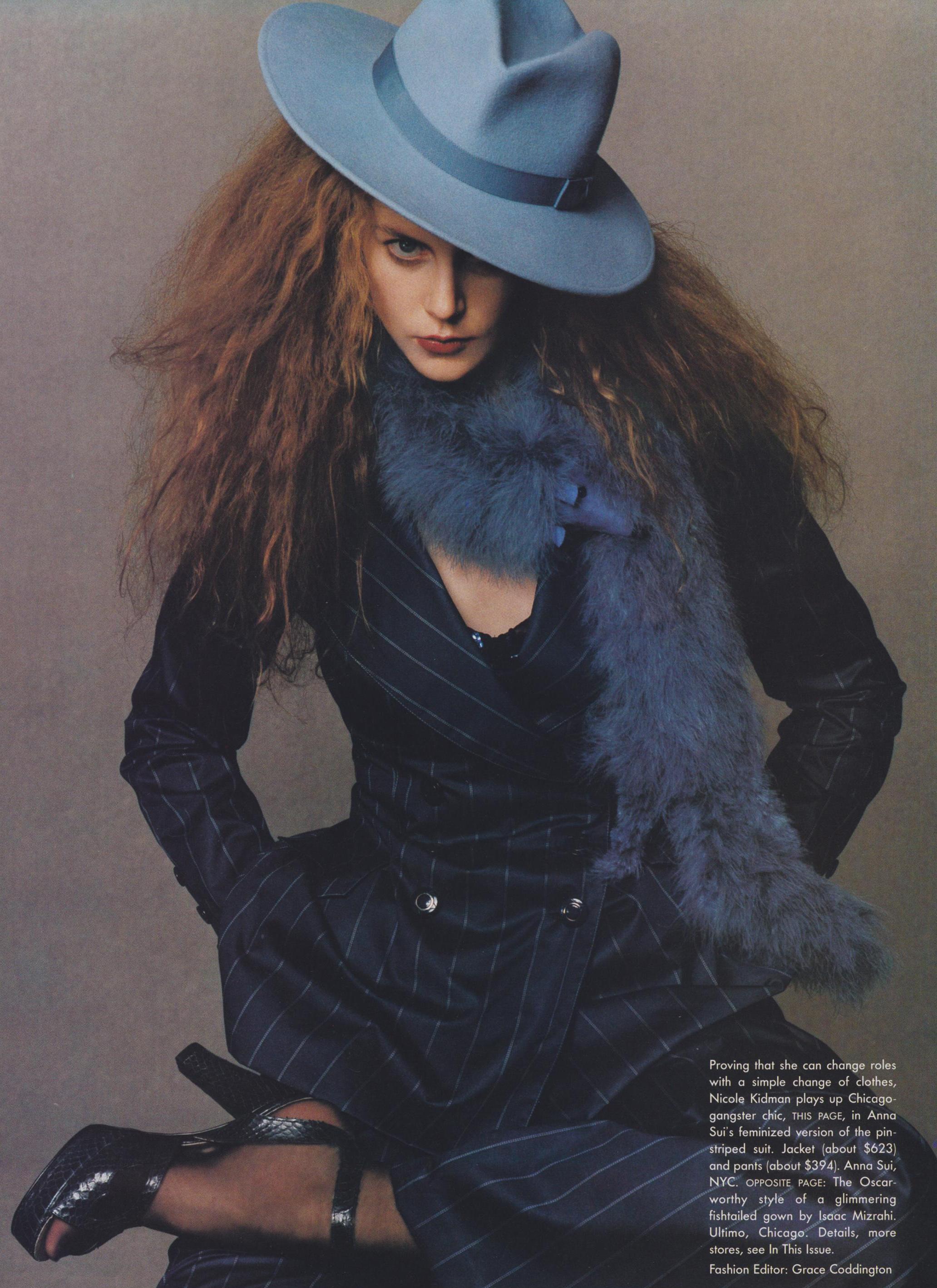 Nicole Kidman in a Sui pinstripe suit. Shot by Steven Meisel for Vogue, February 1995.