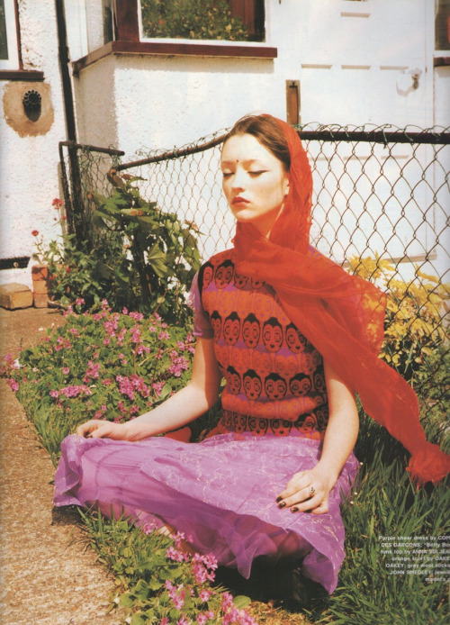 """Audrey Marnay wearing an Anna Sui """"Betty Boop"""" sweater vest over a Comme des Garçons dress. Photographed by Ellen Von Unwerth for The Face, 1997."""
