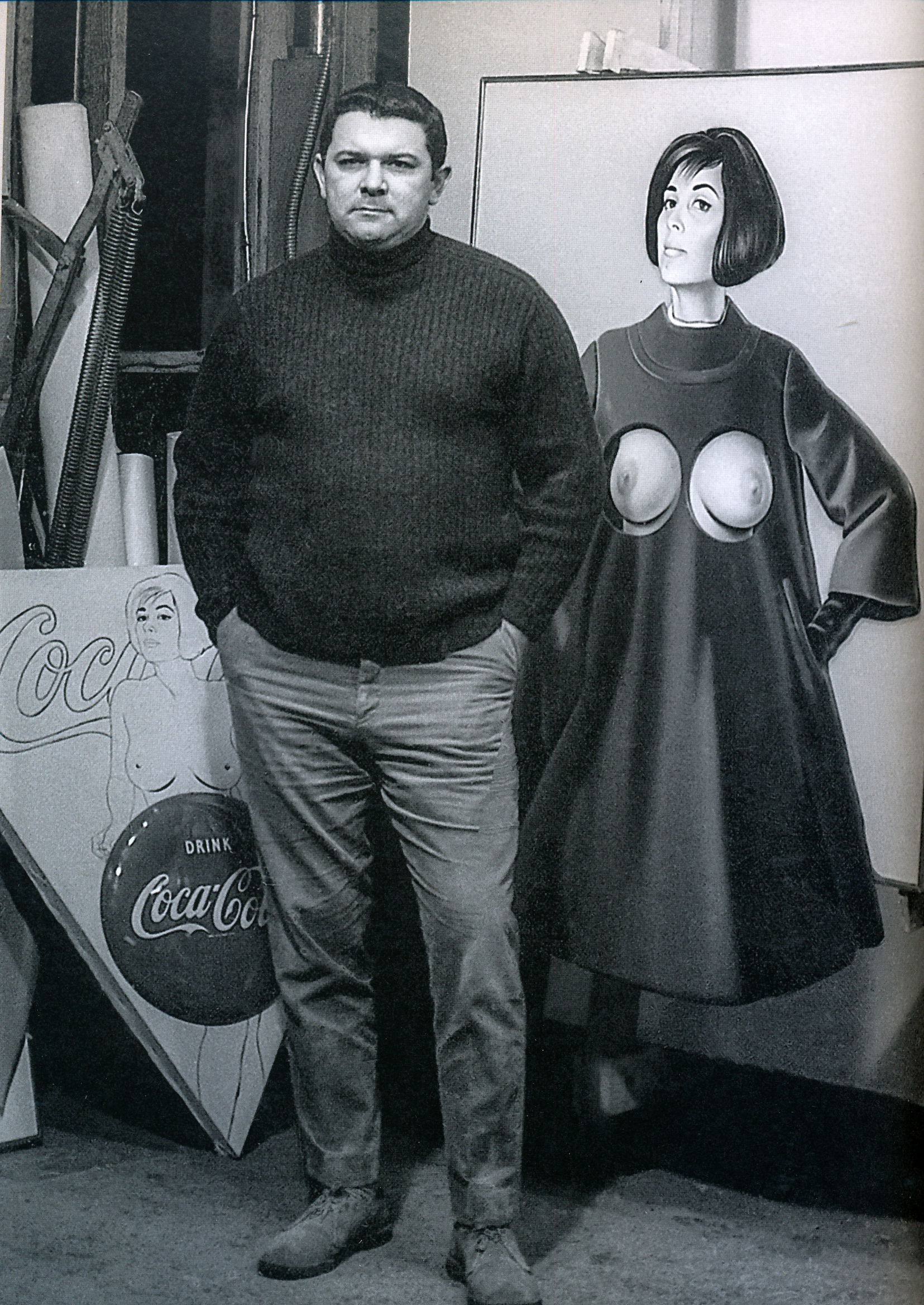 """Mel in front of """"Blue Coat"""" and """"Things go better with"""" in his Union City studio, 1967."""