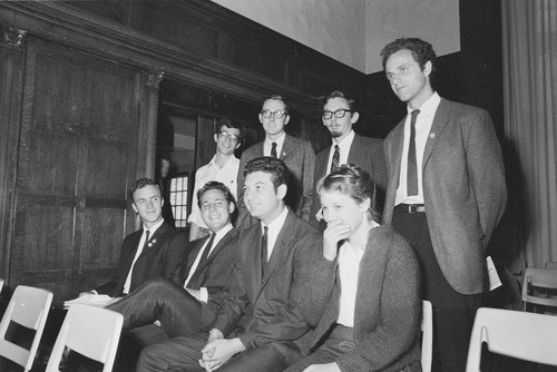 Eight students suspended from Berkeley on Sept 30th, 1964 for operating a table on campus without a permit. David Lance Goines can be seen top left.