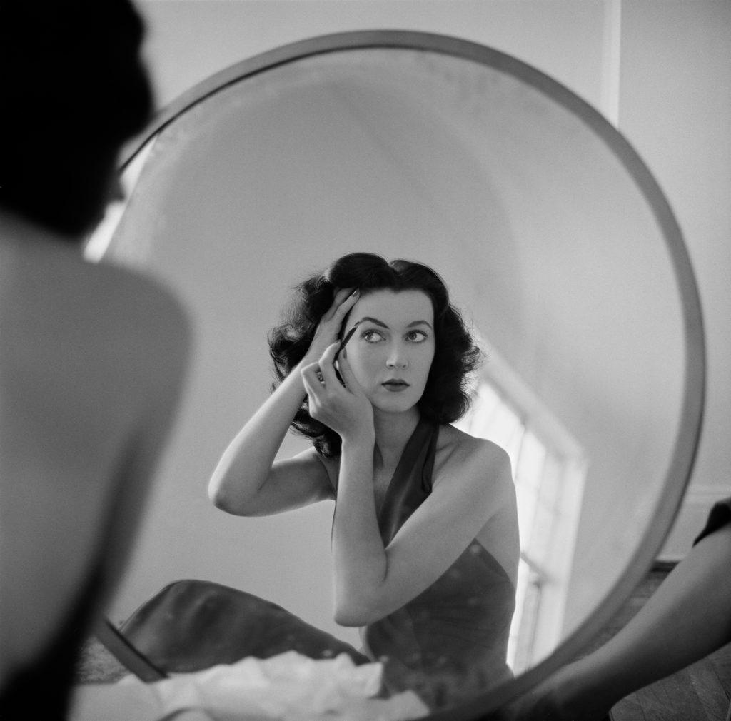 Dovima prepares for a shoot, NYC, 1953
