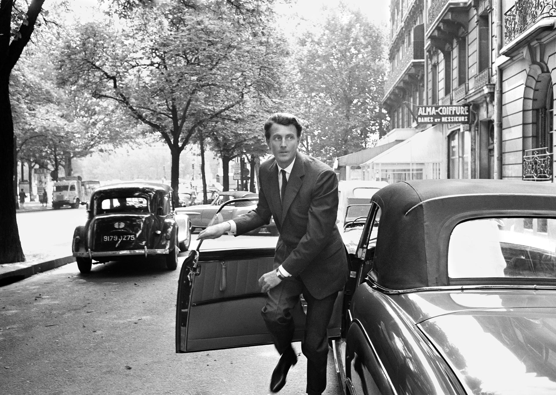 Hubert de Givenchy exits his car in Paris, 1960