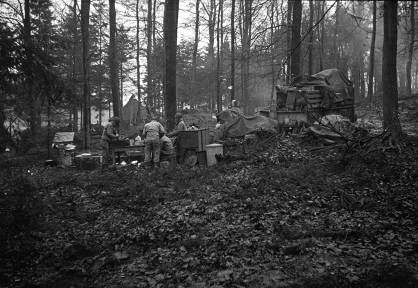 On Christmas, US soldiers of the 331st Regiment received a hot lunch 300 yards behind the front line, Hurtgen Forest, Germany, December, 1944.