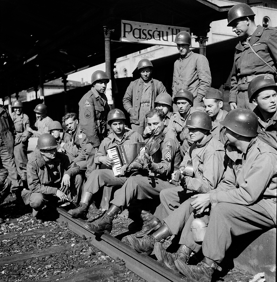Members of the 331st Regiment, 2nd battalion, await rail transport to Cherbourg and a boat home, Passau, September, 1945