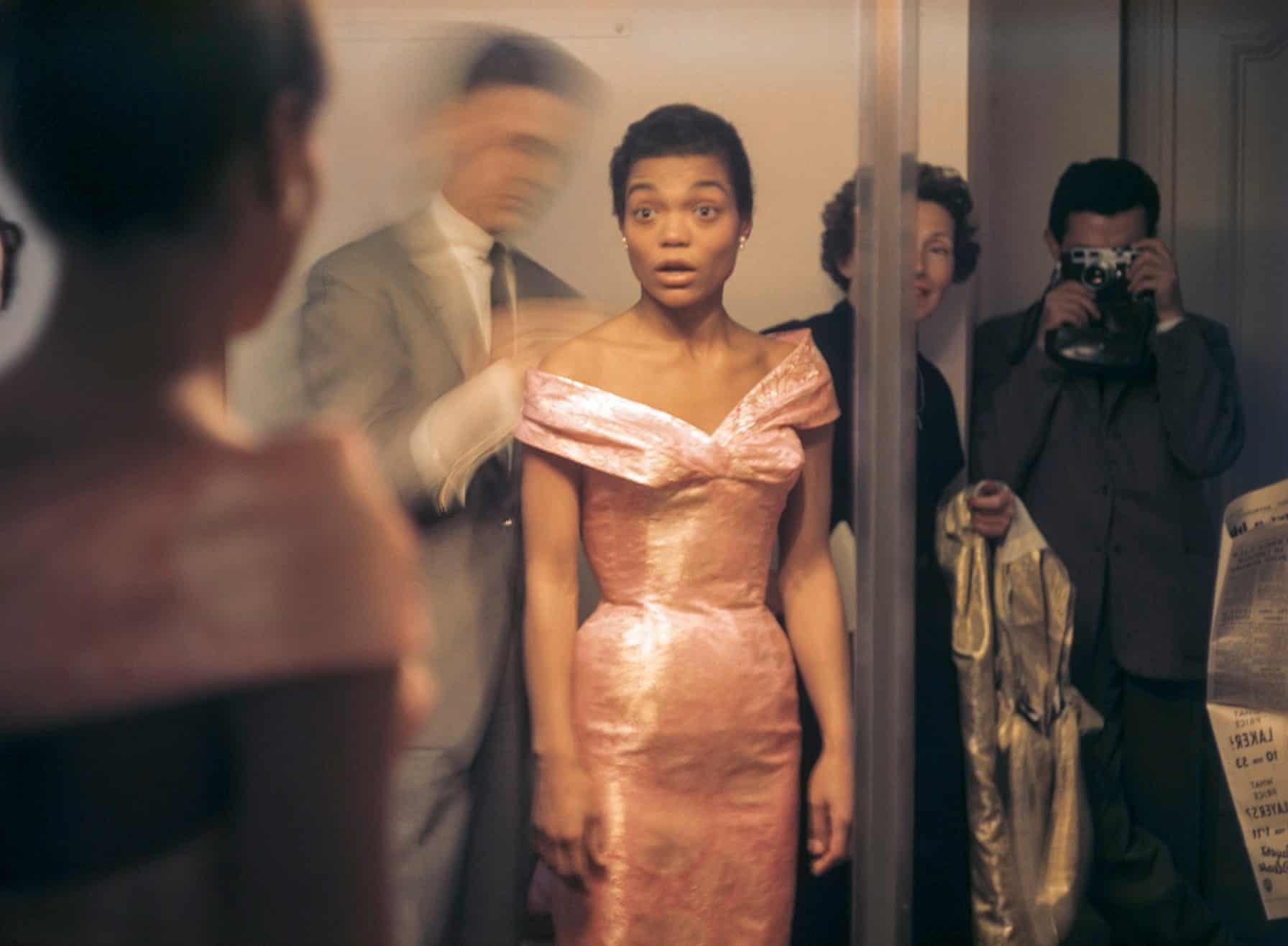 Eartha Kitt looks at her reflection during a fitting with Hubert de Givenchy in Paris, 1961.