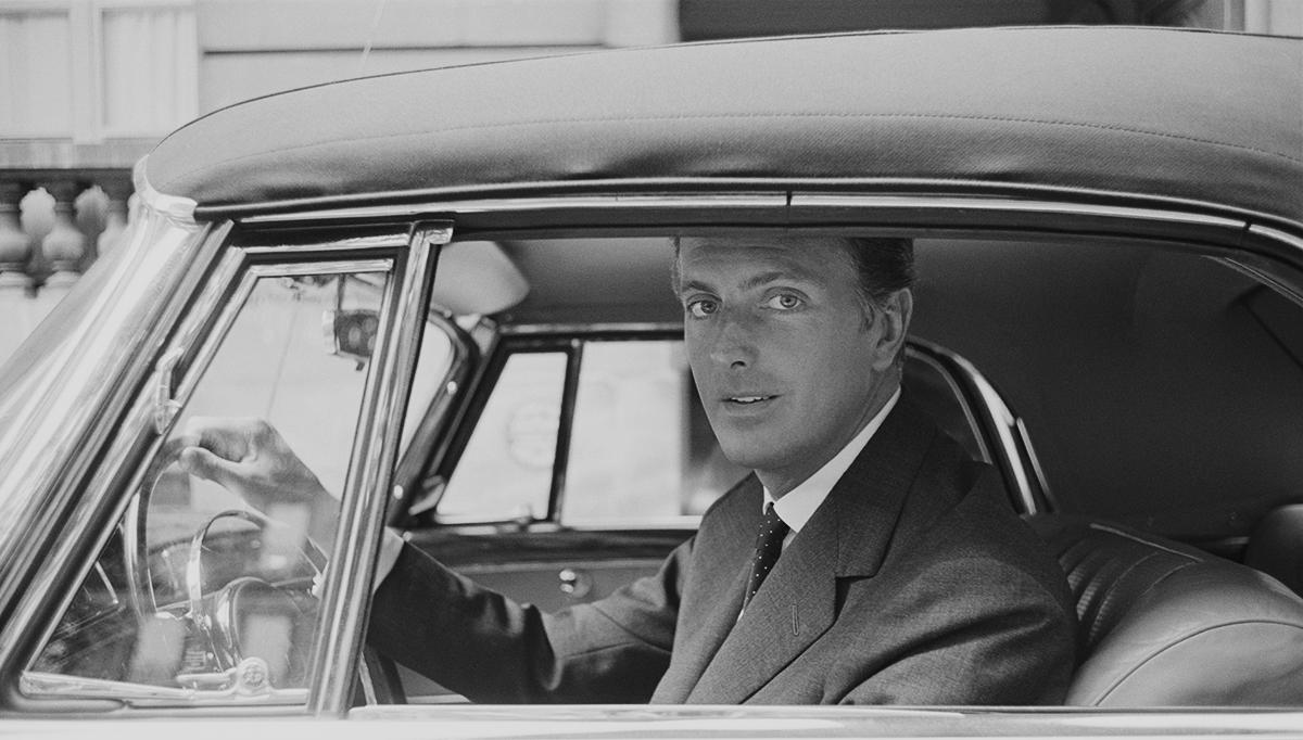 Hubert de Givenchy departs from a photo shoot in his Mercedes, Avenue Montaigne, Paris, June, 1960