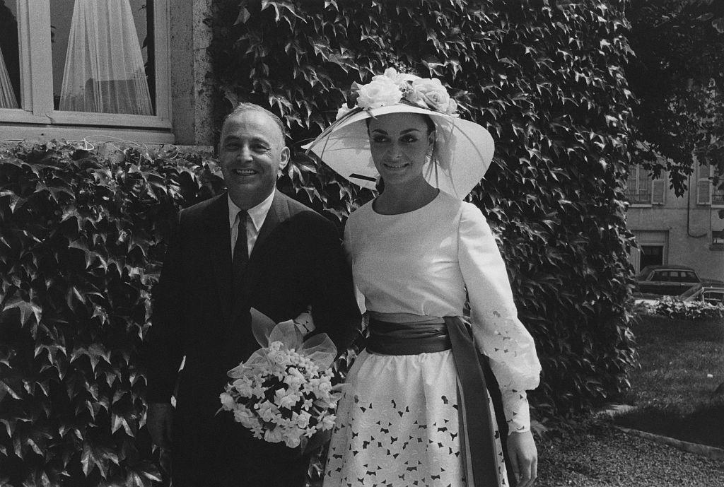 vogue_oct 15 1979_Diane Halfin (aka Diane von Furstenberg) walks outside with a man (possibly her father Leon Halfin) to her wedding ceremony. (Photo by Jack Nisberg.jpg