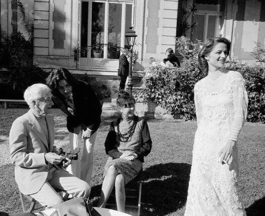 October 1978, Croissy-sur-Seine, France --- Composer and singer Jean-Michel Jarre and actress Charlotte Rampling on their wedding day with photographer Jacques-Henri Lartigue.jpg