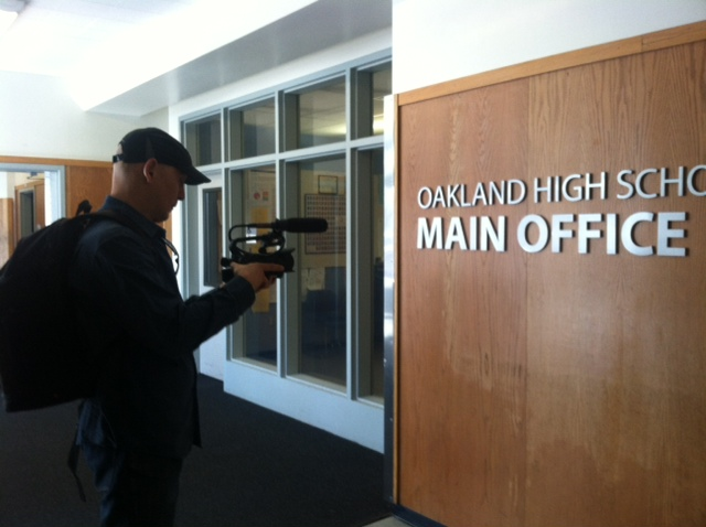 Filming on location at Oakland High School