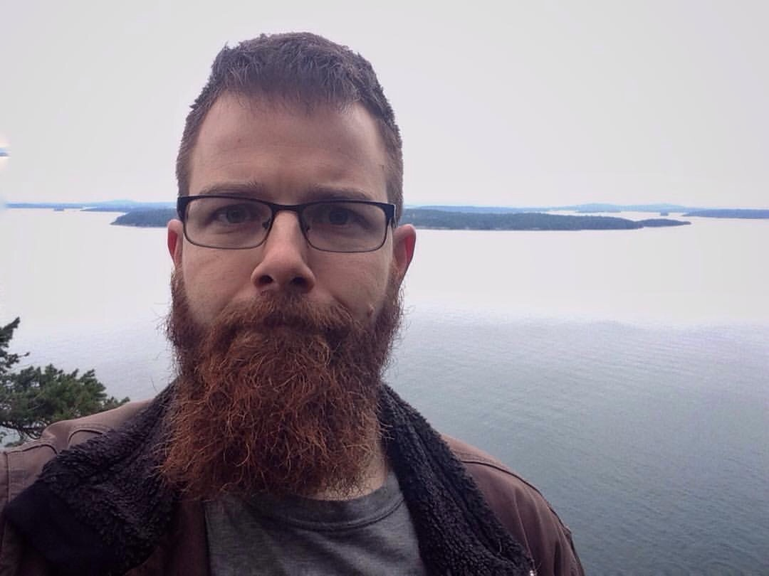 Nick in BC doing an obligatory beard-selfie on a hike.