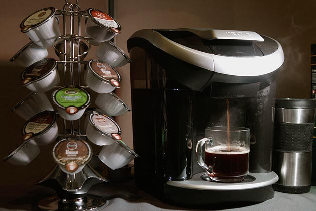 A Keurig machine with the real breadwinners - the k-cups.