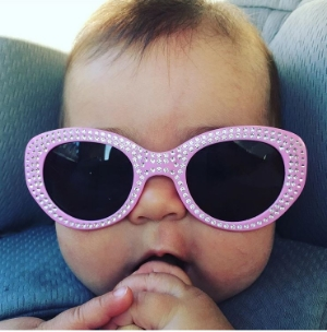 Sunglasses aren't just for mamas! Wearing shades from a young age can reduce eye problems in the future.