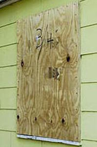 plywood covering a window to protect from storms
