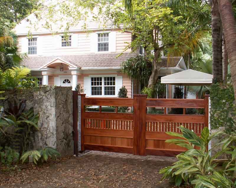 mahogany gates in front of a Miami home