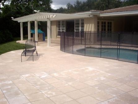 Miami Pool deck with pergola and stone patio