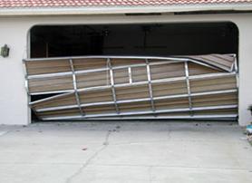 broken garage door after hurricane