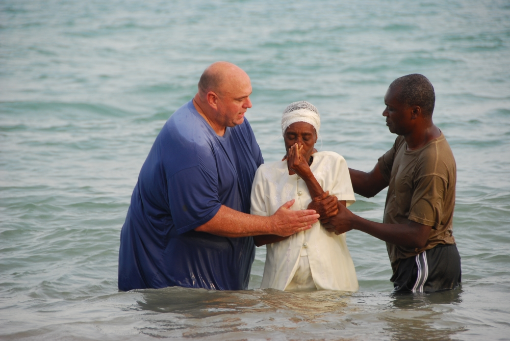 HAITI Bryan-helping-Doorway-to-Peace-with-a-baptism.JPG