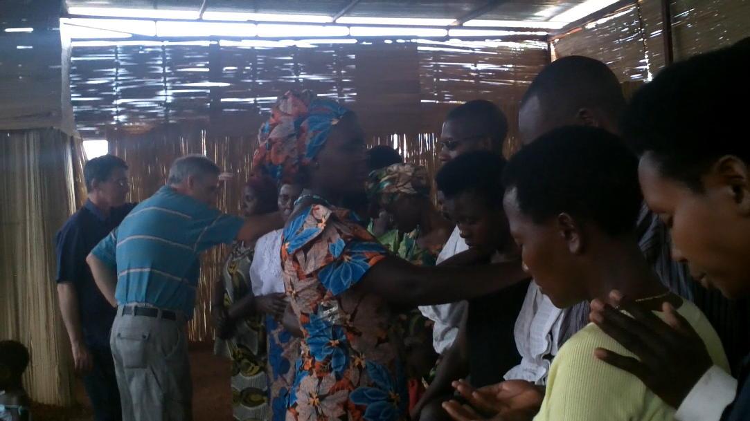 RWANDA - Woman ministering (blurry).jpg