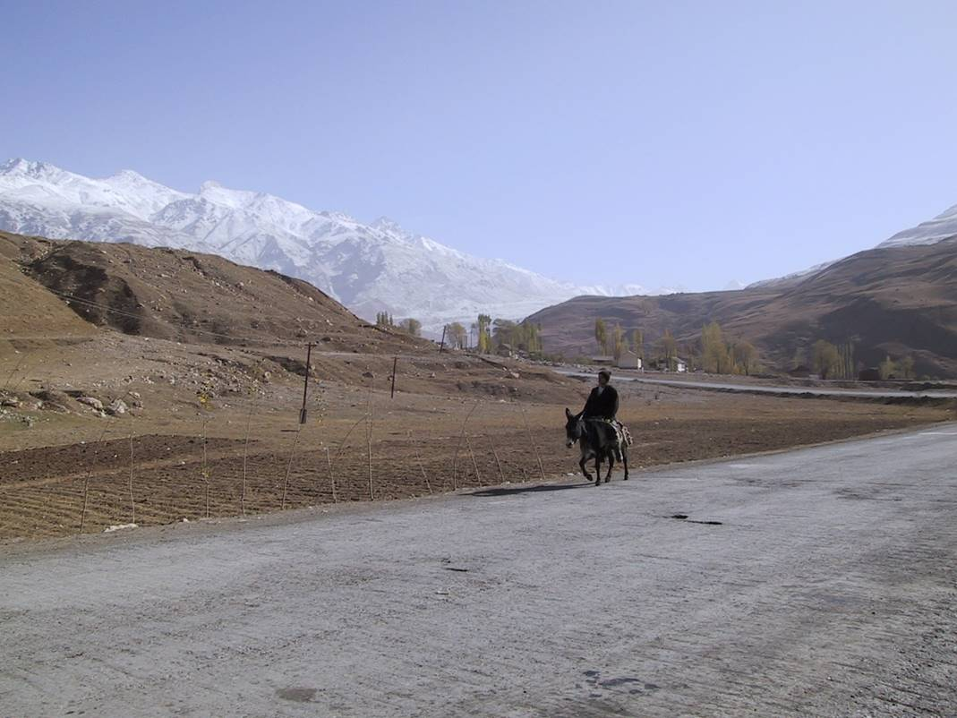 TAJIKISTAN Man riding horse.jpg