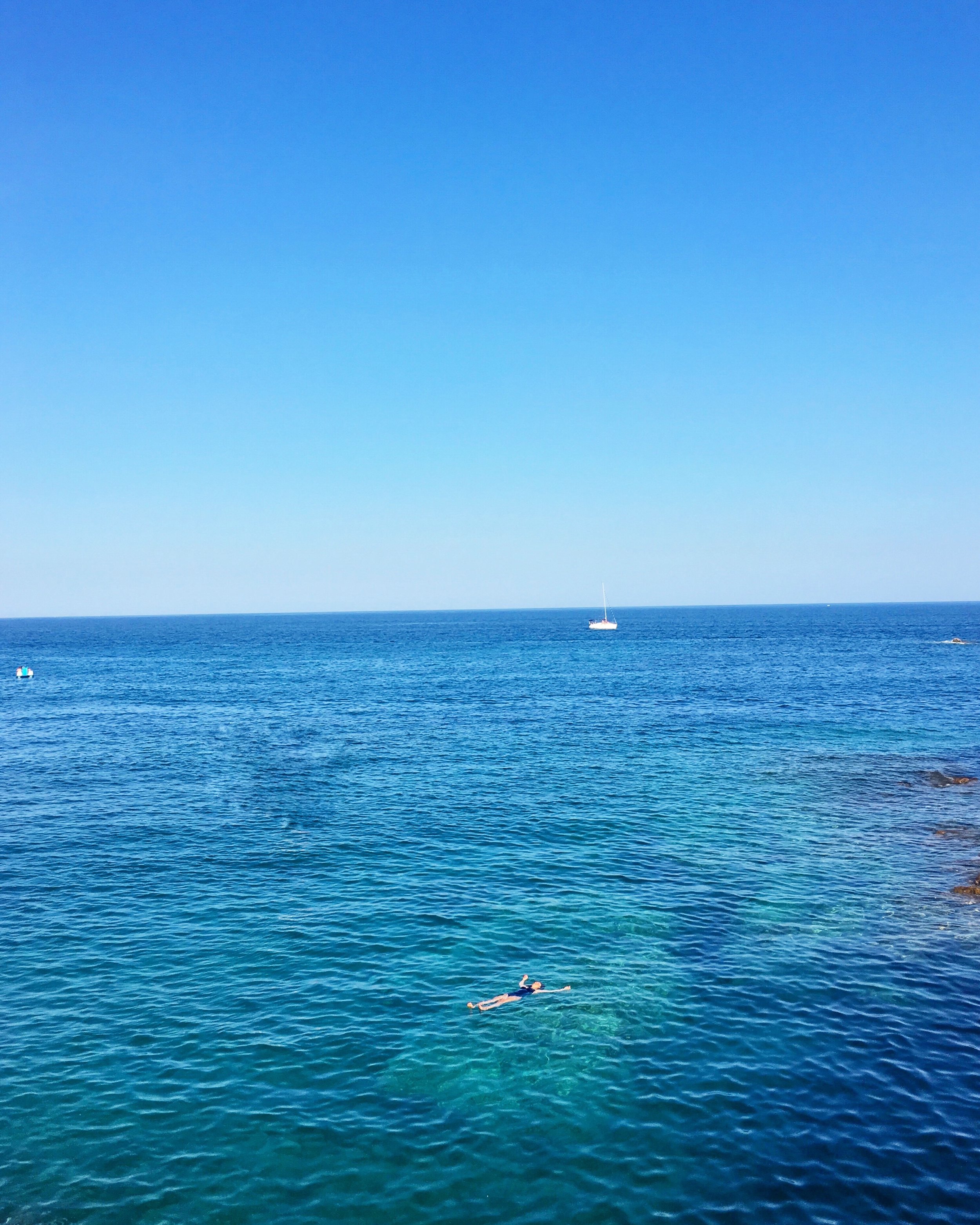 Hallie Applebaum floating in the crystal blue waters in cala sant francesc in blanes - 3 Days* - 📸 H. Applebaum