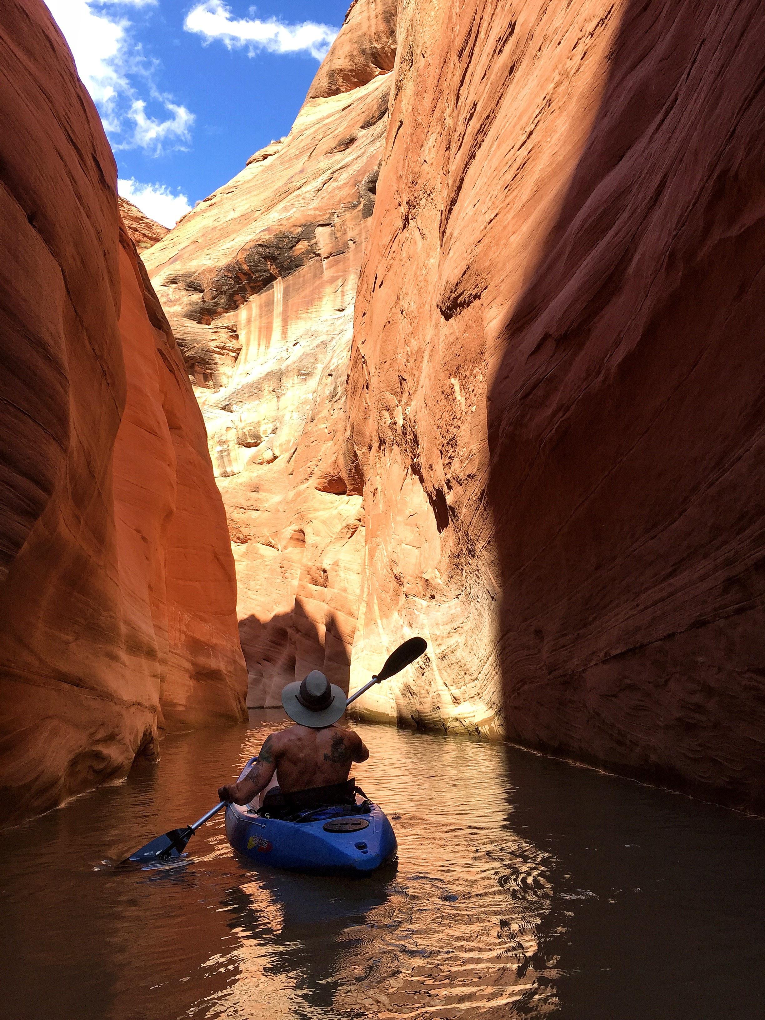 Aaron paddling through a slot canyon in Utah, kayaking in the outdoors - 3 Days*