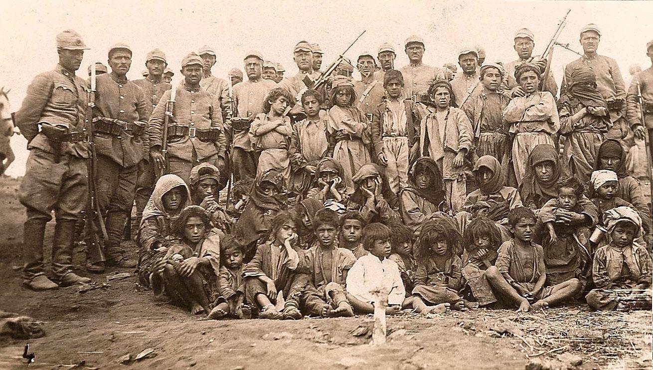 Prisoners in Dersim, held captive by the uniformed Turkish soldiers standing in rear.