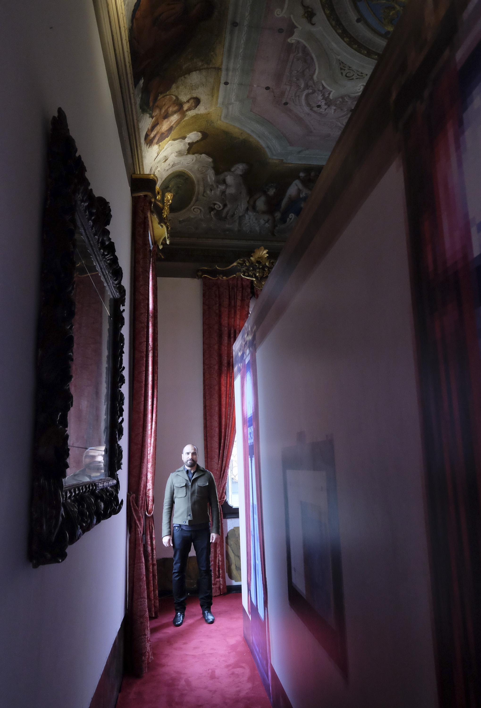 Rashid Rana with his work, A mirror lies vacant at Palazzo Benzon in Venice Photo credit- Marco Secchi 2.jpg