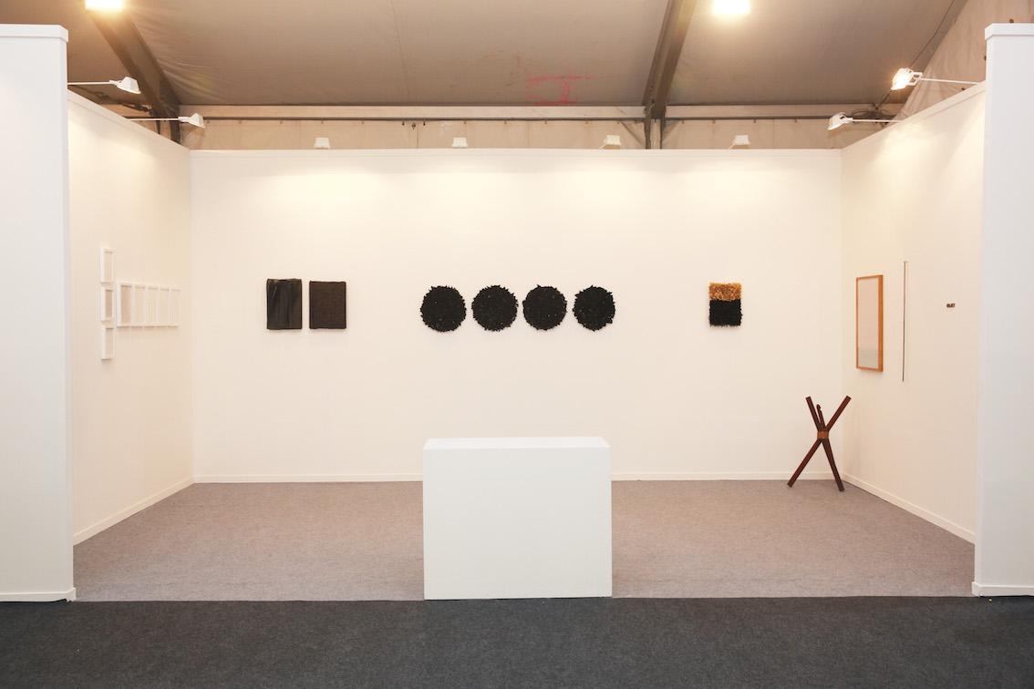 Sabrina Amrani, Madrid, gallery booth presenting works by Joël Andrianomearisoa, Ayesha Jatoi, Waqas Khan, Timothy Hyunsoo Lee and UBIK. Image courtesy Sabrina Amrani.